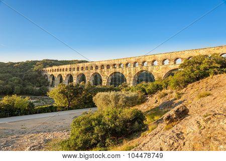 Bridge (aqueduct)Pont du Gard over Gardon river - France poster