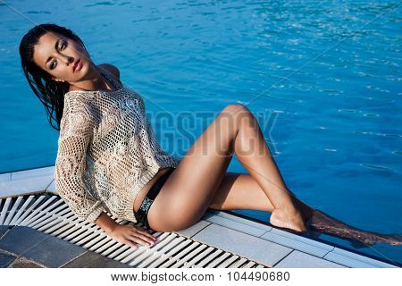 woman near the swimming pool