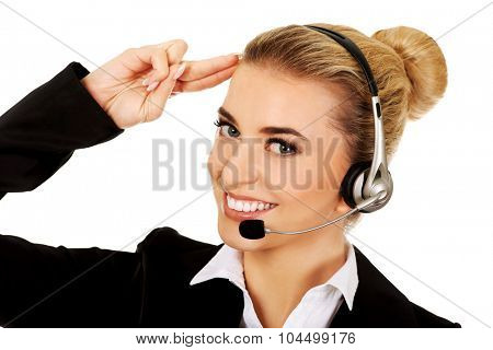 Salute young businesswoman in headphones. poster