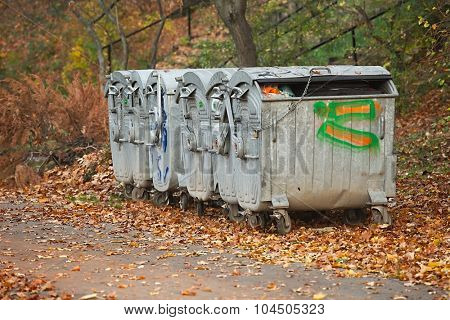 Dumpsters by the walking path