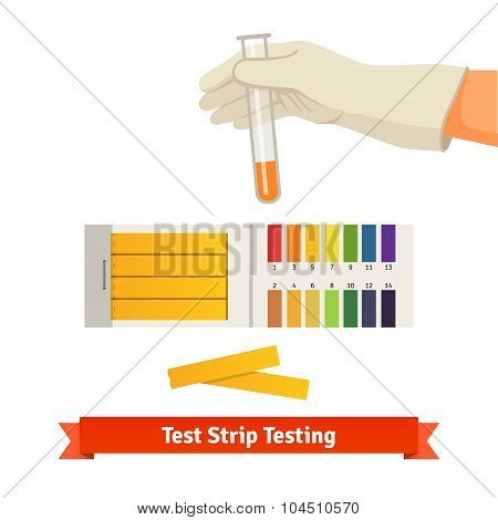 Hand holding test tube with pH indicator