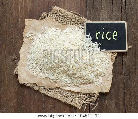Basmati Raw Rice On Wood With A Small Chalkboard