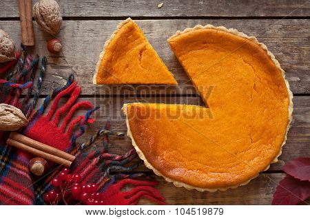 Sweet delicious natural pumpkin tart pie dessert sliced on vintage wooden table background. Autumn c