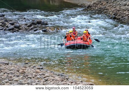 Group of adventurer doing white water rafting activity at Kiulu river.