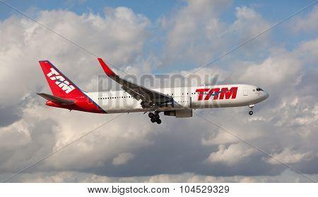 MIAMI, USA - April 29, 2015: Boeing 767 TAM Brazil Airline landing at Miami International Airport.