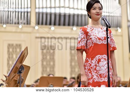 ST. PETERSBURG, RUSSIA - OCTOBER 6, 2015: Soprano Yui Don Ni from Star Sopranos of China on the rehearsal with the Andreyev State Russian Orchestra in the Grand Philharmonic Hall