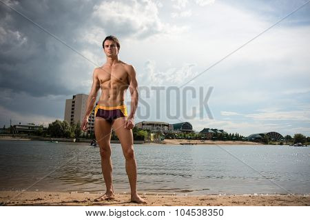 Portrait Of A Sporty, Athletic, Muscular Sexy Man In Swimtrunks