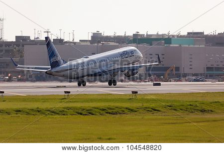 FORT LAUDERDALE, USA - May 24, 2015: A Jetblue Airlines Embraer 190 aircraft landing.