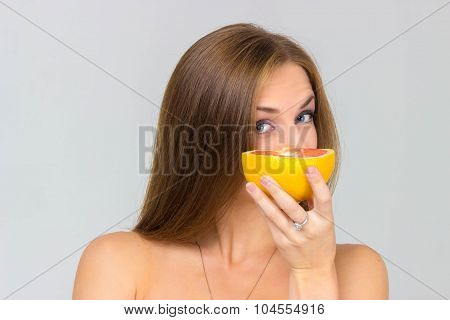 Beautiful Sexy Girl With Grapefruit Isolated