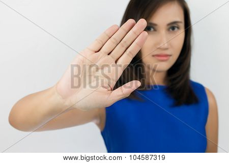 Young Woman Showing Her Denial With No On Her Hand
