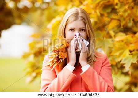 Girl with cold rhinitis on autumn background. Fall flu season. Ill sick sneezing woman. Handkerchief, vaccine against influenza virus Caught Cold Headache Allergy runny nose poster