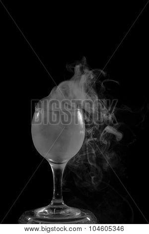 Smoke Shisha In Cocktail Glass On A Black Background.