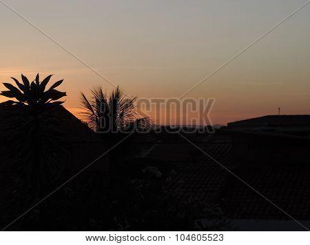 Paisagem da varanda da minha casa durante o pôr do sol