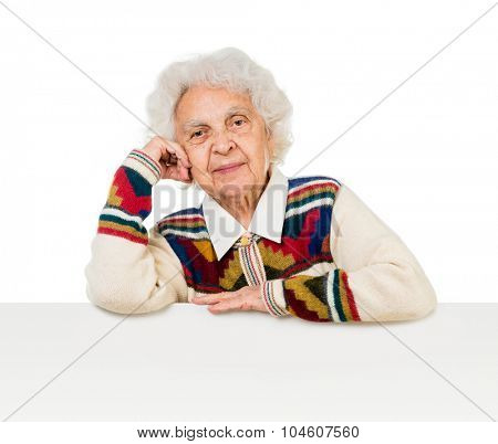elderly woman behind an advertising board over white background