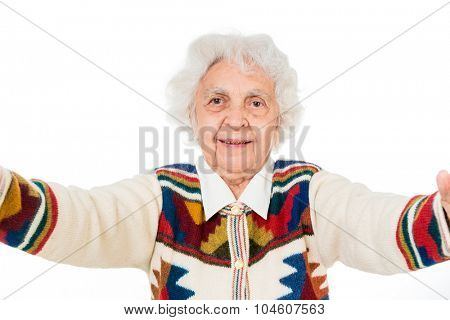 elderly woman taking selfie on a tablet isolated on white background