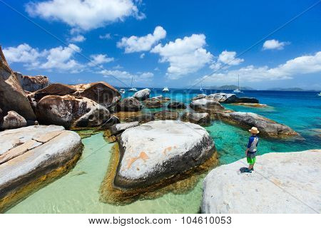 Little boy enjoying view of beautiful scenery of The Baths beach area major tourist attraction at Virgin Gorda, British Virgin Islands, Caribbean