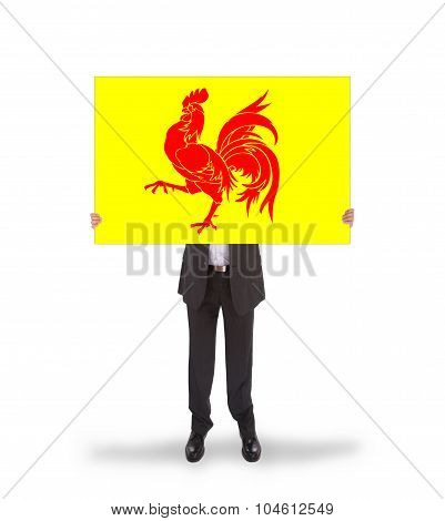 Smiling Businessman Holding A Big Card, Flag Of Wallonia
