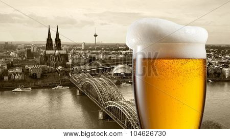 Glass of beer with view of Koeln on background, Germany. Header for website