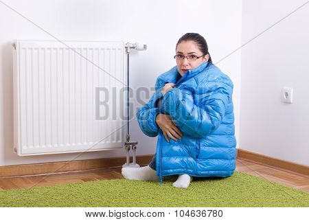 Woman Freezing Next To Radiator
