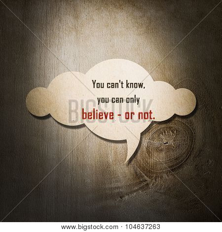 Meaningful Quote On Paper Cloud With Wooden Background