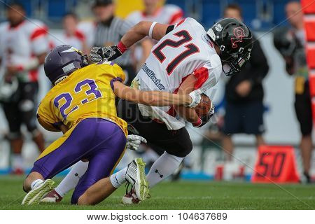 ST. POELTEN, AUSTRIA - JULY 26, 2014: DB Kevin Di Pippo (#21 Lions) intercepts the ball during Silver Bowl XVII.