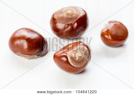 Chestnuts On A White Wooden Background