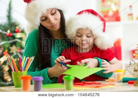 Mother and child cut preparing to Christmas holiday