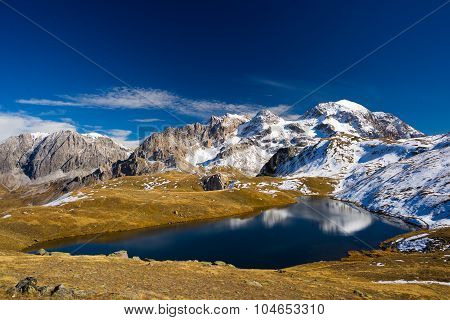 High Altitude Blue Alpine Lake In Autumn Season