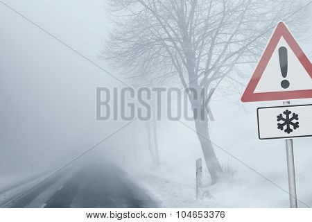 Caution - foggy winter road - risk of snow and ice poster