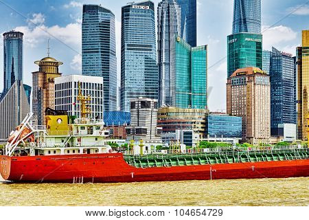 Shanghai, China-  May 24, 2015 : A Large Cargo Ship On The Yangtze River And View On Pudong New Area