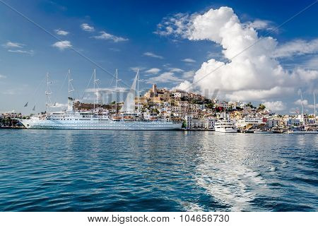 Waterside View To The Dalt Vila Old Town And Moored Vessels In The Port Of Ibiza, Balearic Islands.