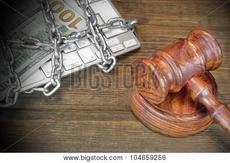 Cyber Crime Concept, Judges Gavel, Keyboard,  Chain On The Table