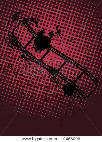 vector illustration of a film stripe on a grunge background poster
