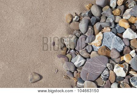 Pebbles On Beach Background