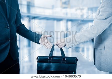 business transfer. handover of a suitcase partners