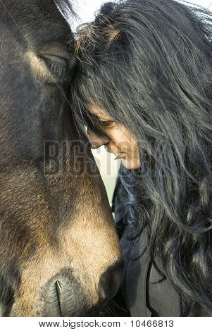 Asian woman with her horse.