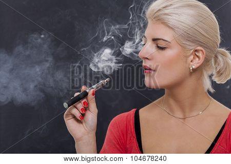 Stylish Blond Woman Smoking An E-cigarette