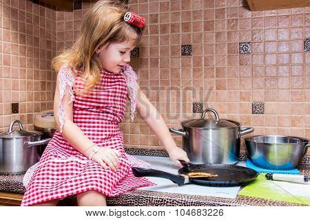Little Girl Cooks Pancakes