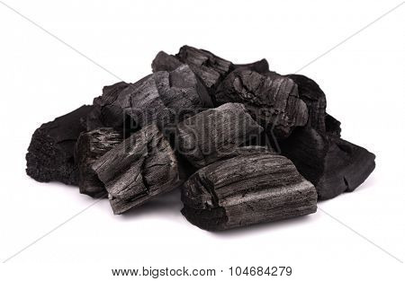 Pile of charcoal isolated on white