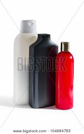 colored plastic bottles with shampoo and mask for hair on a white background isolated poster