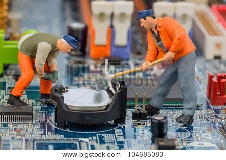 computer board and worker, symbol photo for computer failure, maintenance, data security