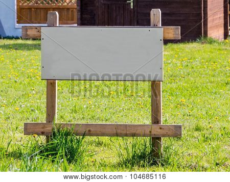on a meadow there is a sign
