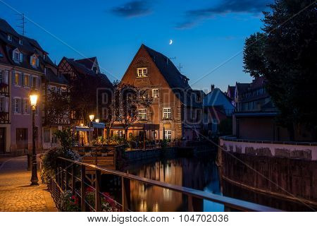 Traditional french houses on the side of chanel Petite Venise, Colmar, France, at night.
