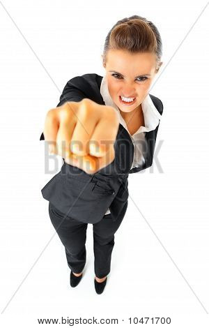 Full length portrait of furious modern business woman punching