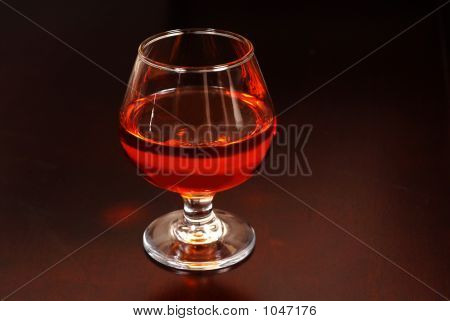 Warming Snifter Of Amaretto Liquor On A Table
