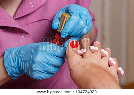 Chiropody Spa Salon. Applying Gel Nail Polish.