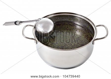 Kitchen Spoon Of Metal Leaned On A Pot Of Soup.