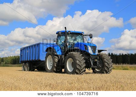 New Holland T7.250 Tractor And Agricultural Trailer On Field
