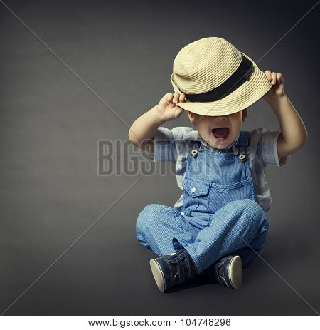 Baby Boy In Fashion Jeans, Hat Covered Eyes. Child Beauty, Well Dressed Boy, Gray