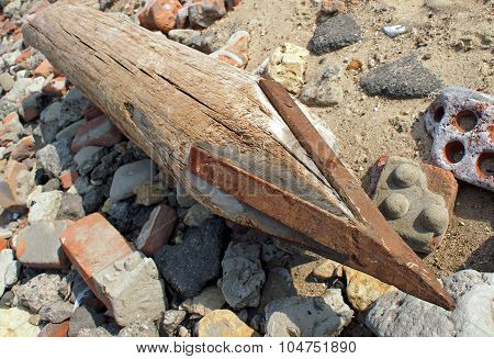 Wooden Pole With An Iron Tip At A Construction Site